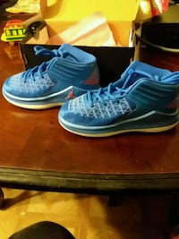 pair of blue Nike basketball shoes