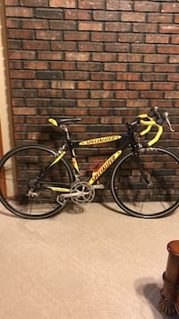black and yellow Specialized road bike