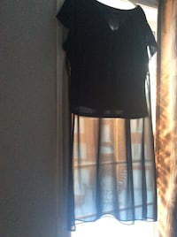 Stylish Black top with sheer bottom. Like new size large  Laval, H7X 3R8