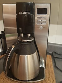 stainless steel and black Mr. Coffee coffeemaker