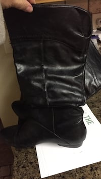 pair of women's black leather wide-calf boots