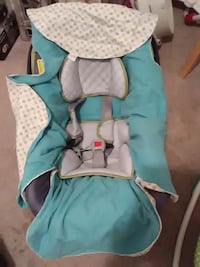baby's white and teal car seat cover