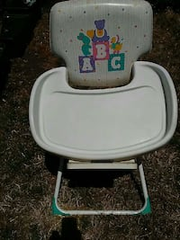 baby's white and gray high chair