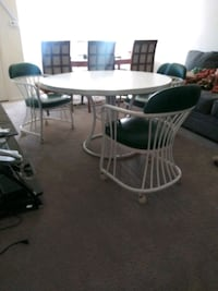 oval white table with four chairs dining set Frederick, 21702