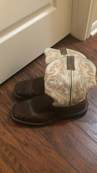 pair of brown leather cowboy boots 1294 mi