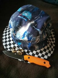 black and blue bucket hat and orange knife