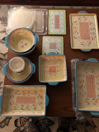 24 pc.Temptations Springfetti stoneware set.$50.00/firm-comes with lid-it , wire racks , trivets and plastic storage covers. Redlands, 92374