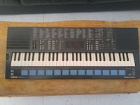 black Yamaha electronic keyboard Milton, L9T