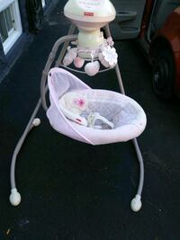 baby's white and pink cradle n swing