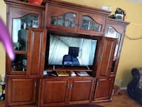 brown wooden TV hutch and flat screen TV 2403 mi