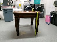 black and brown wooden table Port St. Lucie, 34953
