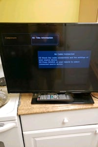 black flat screen TV with remote Falls Church, 22042