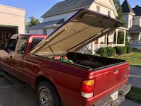Red fiberglass tonneau cover for 6 ft box
