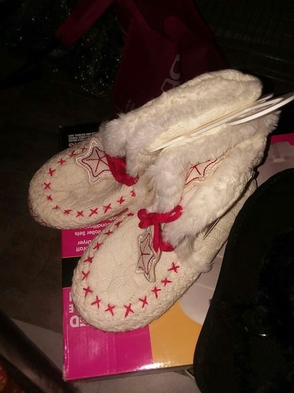 pair of white-and-red knit sheepskin boots
