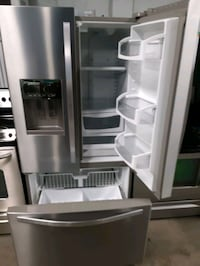 WHIRLPOOL STAINLESS STEEL FRENCH DOORS FRIDGES WORKING PERFECTLY  Baltimore, 21201