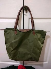 green and black leather tote bag