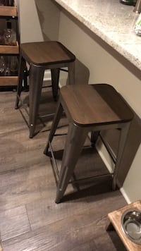 two brown wooden bar stools 38 km