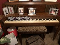 Brown wooden framed upright piano South Elgin, 60177