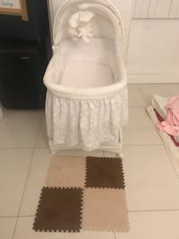 Clean and neat white bassinet new and never used 929 mi