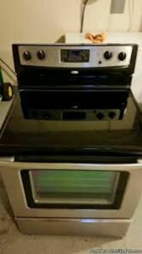 black and silver electric smooth top range oven