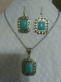 silver-colored chain necklace with turquoise pendant and pair of hooked earrings