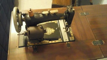 vintage antique sewing machine with cabinet