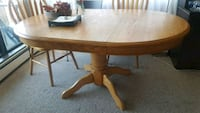 oval brown wooden dining table Burnaby, V5H 1P2