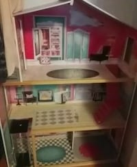 white, red, and brown 3-storey doll house