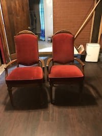 2 brown wooden framed red padded armchairs 4 with out arms  Guelph/Eramosa, N0B