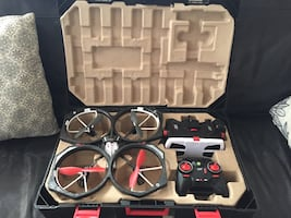 Black and red and gray and black quadcopter drone box