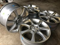 gray 5-spoke car wheel set 551 km