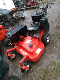 Walk behind lawnmower  w/ bagger  Runs exc .very low hours