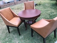 two brown wooden framed brown leather padded chairs