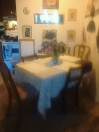 Wood table with four mismatched antique chairs Victoria, V8T 3Y9