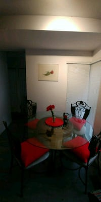 round glass top table with four chairs dining set Montréal, H3E 1K8
