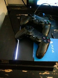 black Sony PS4 console with controller Long Beach