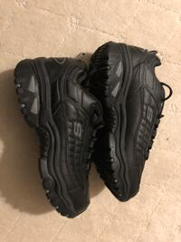 Pair of black skechers size 9 Calgary, T2A 3J1