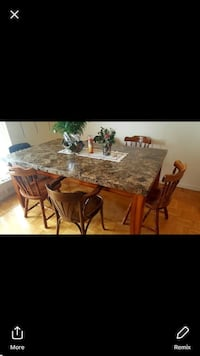 rectangular brown wooden table with chairs Toronto, M9C 1G7