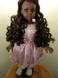 female doll in white and purple dress