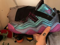 pair of gray-and-pink Nike basketball shoes Mount Airy, 21771