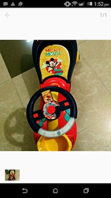 toddler's black and red Mickey Mouse print ride and stride toy