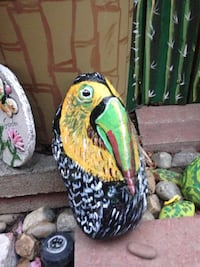 yellow green and red bird figurine