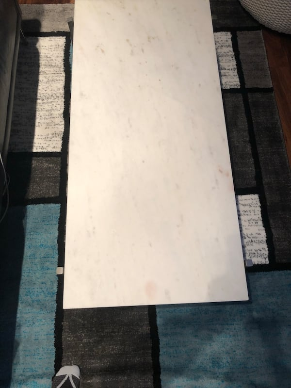 WHITE MARBLE COFFEE TABLE WITH ANTIQUED SILVER BASE 44c87316-fdfb-4bab-90bf-075de0b11af9