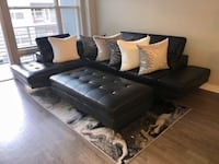 Black sectional leather couch , ottoman , pillows and rug Columbia, 21044