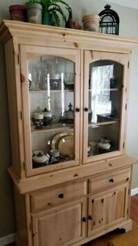 brown wooden framed glass display cabinet Rochester, 03839