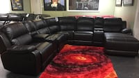 Reclining Sectional with Consoles and Chaise.