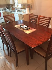 Brown wooden dining set includes dining table and 6 chairs