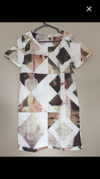 white and brown floral textile