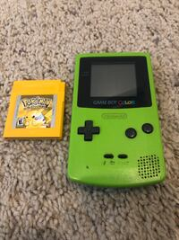 Green Gameboy Color With Pokemon Yellow