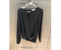 MICHAEL KORS black blouse. Low cut. Size small. Loose fitting. Paid $200 Burnaby, V5B 1H1